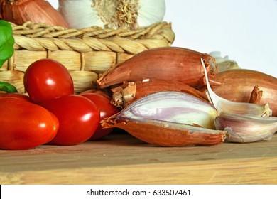 Italian cuisine, tomato sauce. Ingredients for preparation, tomato, onion, garlic, basil