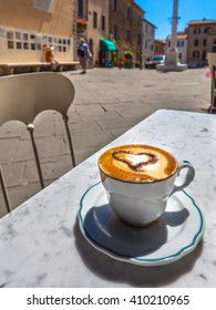 Italian Cup of Cappuccino cacao in heart shape at a Cafe Terrace with Street View, Italy