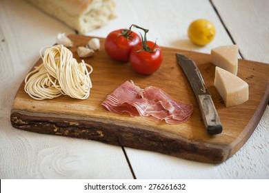 Italian delectables on a unique handmade cutting board