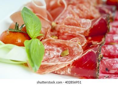 Italian Delicious Antipasto with ham and bresaola, selective focus