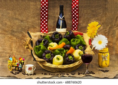 Italian delights. Still life with different colored peppers, wine,espresso coffee and Sicilian horse cart..