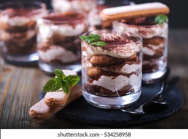 Italian dessert tiramisu in glass, sweet food