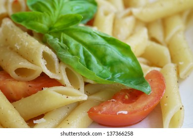 Italian dish, pasta with fresh tomato and basil