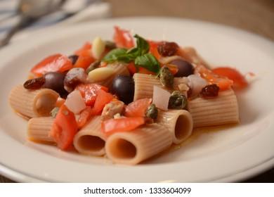 italian dish with swardfish tomato capper oliva