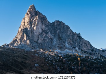 Italian Dolomites mountain peaceful sunny evening view from Giau Pass. Picturesque climate, environment and travel concept scene.