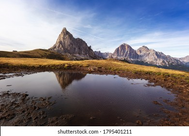 Italian Dolomites, Passo Giau - view of the peaks of the Dolomites, which are reflected in a small mountain lake at sunset with beautiful light.