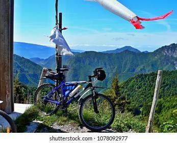 Italian Dolomites-bike and view from the pass Tremalzo