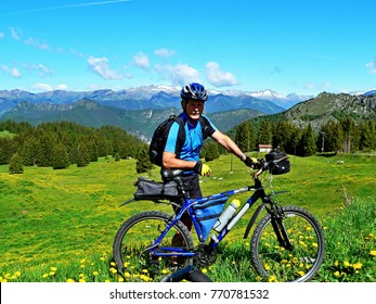 Italian Dolomites-cyclist and view from the Tremalzo