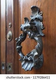 Italian door, detail. Elegant doorknocker.