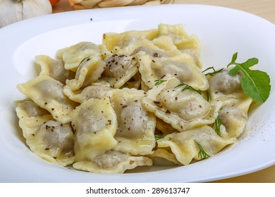 Italian dumplings Ravioli with fresh herbs and spices