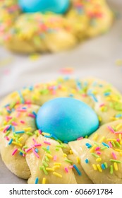Italian Easter bread with blue colored egg and sprinkles.