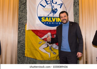 Italian elections candidate and Lega Nord current leader Matteo Salvini posing with the Sicilian flag at the end of a politcal rally. Messina, Italia - 2/14/2018