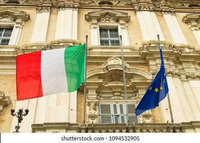 italian and european flags on a balcony of the italian army academy - modena, ducal palace