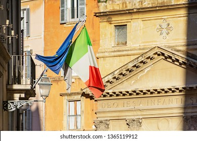 Italian and european union flags with building fasade in Rome