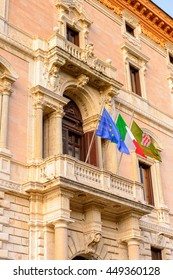 Italian and European Union flags on a balcony of the City Hall of  Perugia, Umbria, Italy