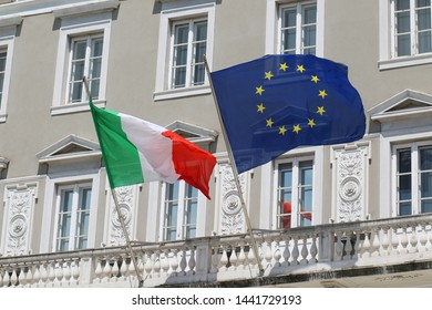 Italian and European Union flags outside on building facade