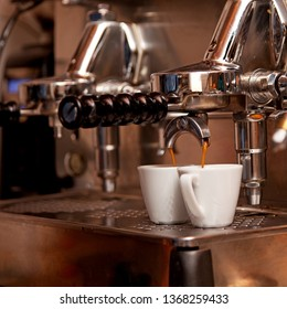 Italian expresso machine on a counter in a restaurant or bar making fresh coffee.