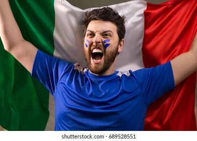 Italian fan holding the national flag