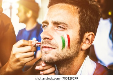 Italian Fan Ready for the Competition, Painting Flag on Cheeks