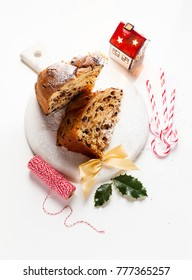 Italian festive bread panetton with chocolate on the table decorated for Christmas.  New Year's traditional dessert