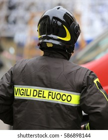 Italian firefighter with protective helmet and the word VIGILI DEL FUOCO meaning Firefighters in Italian