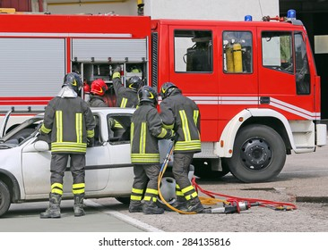 italian firefighters relieve an injured after an accident during a practice session in the fire station