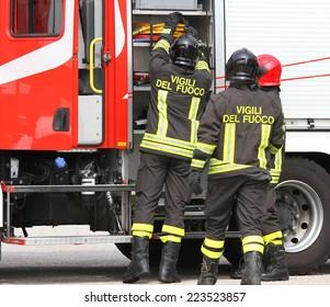 Italian firefighters working near the fire truck when handling an emergency