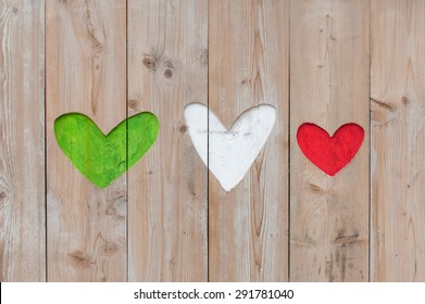 Italian flag colors carved into wooden love hearts