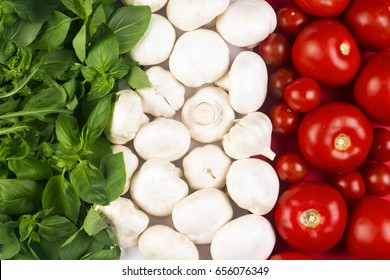 Italian flag from Italian food ingredients: basil, mushrooms, garlic, tomato.