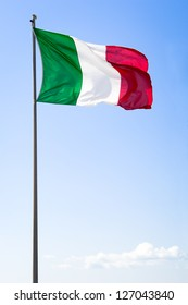 italian flag in front of blue sky