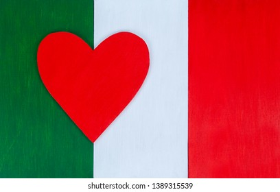 Italian flag and heart, love for Italy & Italian culture - painted wooden background for rustic, vintage and authentic styles - il tricolore of the nation of Italy.