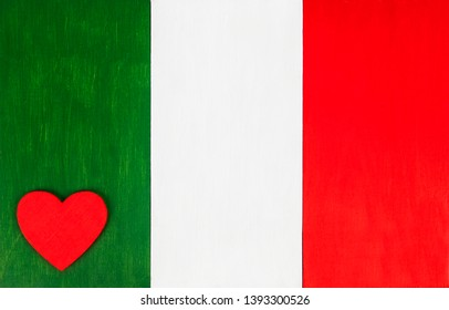 Italian flag with love heart - background with 'il tricolore' flag colors of Italy, for Italian culture & lifestyle, with space for text / design.