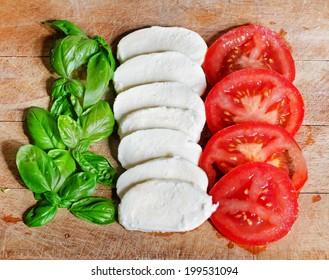 italian flag made of  food concept. Italian tasty food. italian caprese salad made of mozzarella, basil and tomatoes.