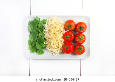Italian flag made with Tomato pasta and Basil