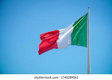 Italian flag on a blue sky