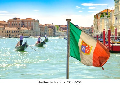 Italian flag on grand canal in Venice