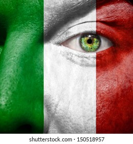 Italian flag painted on mans face to support his country Italy