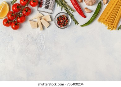 Italian food background with pasta, spices and vegetables. Top view, copy space.