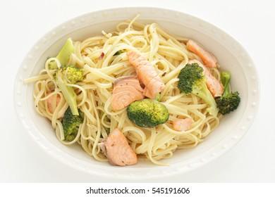 Italian food, broccoli and salmon fish linguine pasta