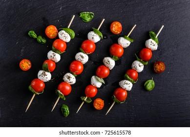 Italian food - caprese salad - skewer with tomato, mozzarella and basil, mediterranean diet concept
