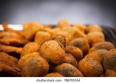 Italian food. Close up fried olives ascolane . Typical regional dish. Black background