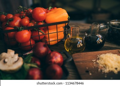 Italian food cooking ingredients on dark rustic background. Healthy vegetarian eating and cooking with various vegetables ingredients. Clean food concept. Toned image. Healthy foods.