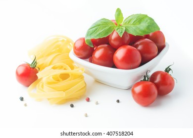 Italian food cooking ingredients. Pasta, tomatoes, basil isolated on white background