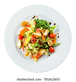Italian food. Delicious salad with cheese mozzarella and fresh tomatoes isolated on white background. Top view, flat lay