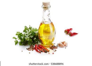 Italian food & drink healthy diet concept: Mediterranean spice vegetable herbs & healthy cuisine. Olive oil chili pepper cayenne pepper garlic  & parsley. Isolated on white