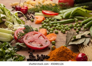 Italian food ingredients on flat wooden background