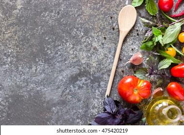 Italian food ingredients on slate background. Organic vegetables. Cooking, Healthy Eating or Vegetarian concept. Top view.