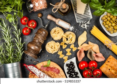 Italian food ingredients with pasta and herbs