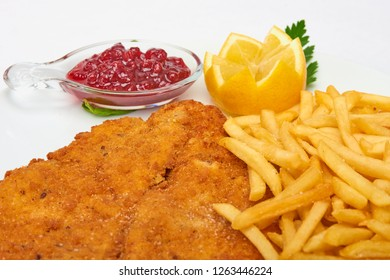 Italian food, Milanese schnitzel with fries  served on white plate, isolated on white background