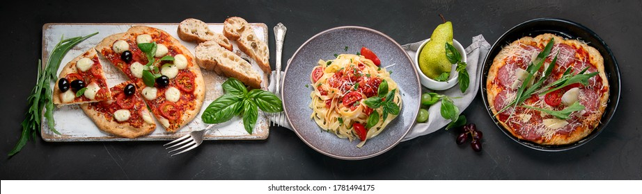 Italian food  on dark background with pasta, pizza, top view, panorama, banner
